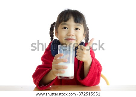 Asian girls are drinking milk on white background.