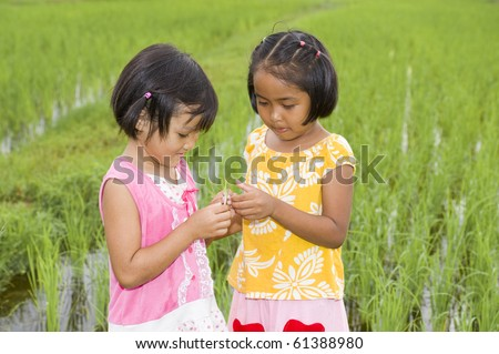 asian girls with grasshopper - stock photo