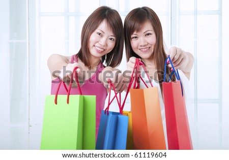asian girls with shopping bags - stock photo