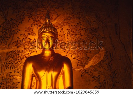 Asian Golden Buddha sign of peace in Thai Temple space for text