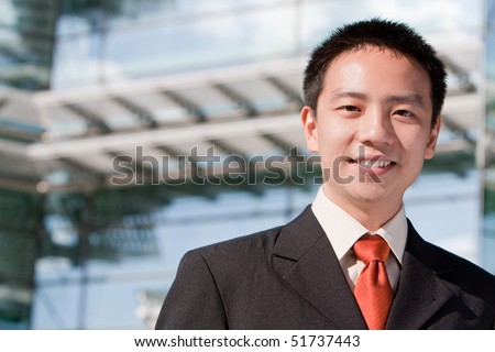 Asian good looking business man in a formal suit with tie - stock photo