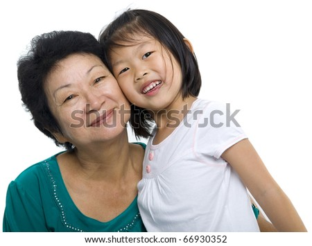 Asian grandmother and grandchild on white background - stock photo