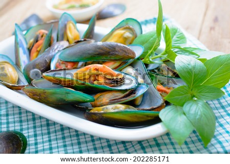 asian green mussel with spicy seafood sauce  - stock photo