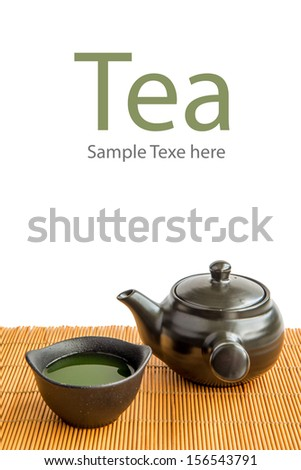 Asian Green tea set on bamboo mat(Green tea and chopsticks) - stock photo