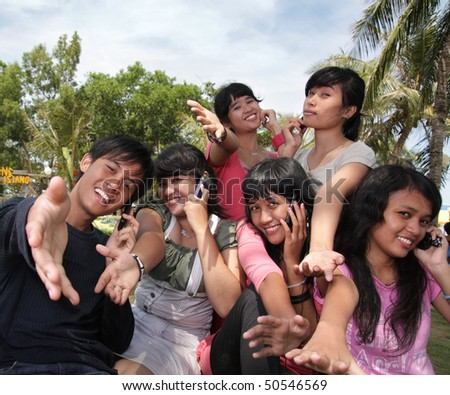 asian group cheerful outdoor - stock photo