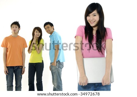 Asian group of happy friends â??focus on girl holding a laptop computer - stock photo