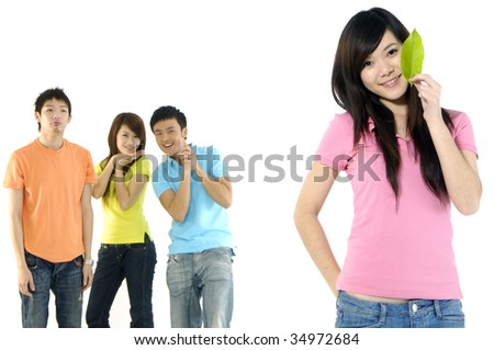 Asian group of happy friends â??focus on girl holding leaf