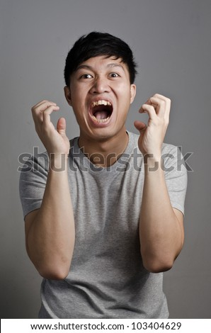 Asian guy is in a stressful situation - stock photo