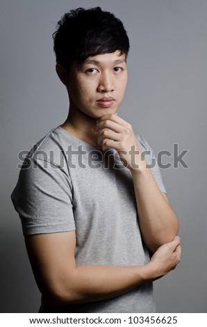 Asian guy on gray background - stock photo