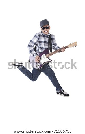 Asian guy with guitar jumping isolated on white - stock photo