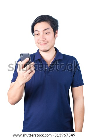 Asian guy with mobile phone in hand speaking, smiling, isolated on white background.