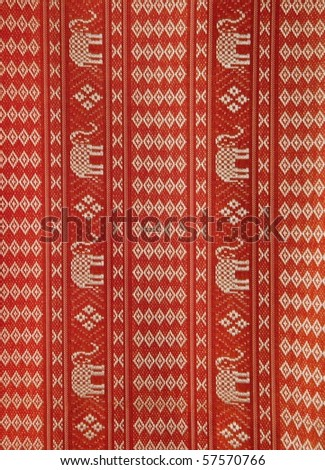 Asian hand-made fabric with little golden elephant texture - stock photo
