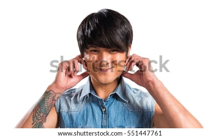 Asian handsome man covering his ears