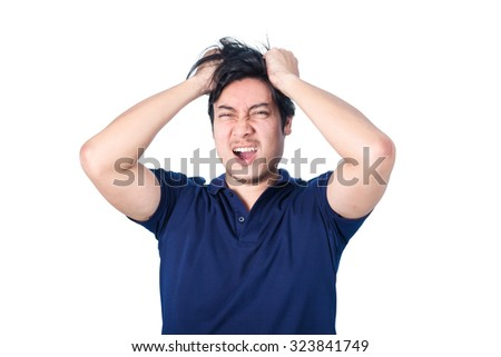 Asian handsome man holding his head frowning with worry screaming. Man pulling his hear for worry, sadness, desperation, so serious, funny, isolated on white background - stock photo