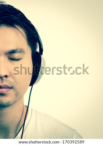 Asian handsome man listen headphone sepia old film look process