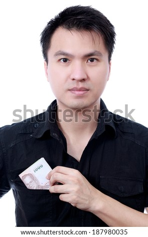 Asian handsome man show banknotes, isolated  - stock photo
