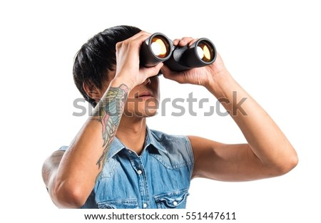 Asian handsome man with binoculars