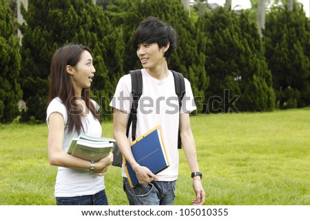 Asian happy college student at a campus - stock photo