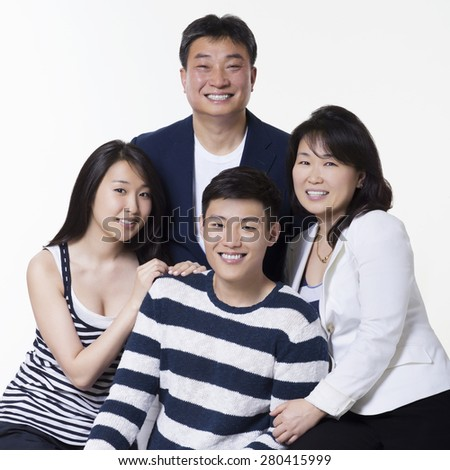 Asian, Happy Family Portrait, blue and white strips against white background