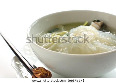 Asian healthy cuisine, Chicken rice noodles in soup - stock photo
