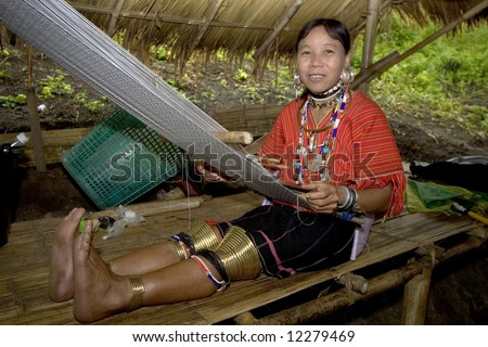 Asian hill tribe with large earrings - stock photo