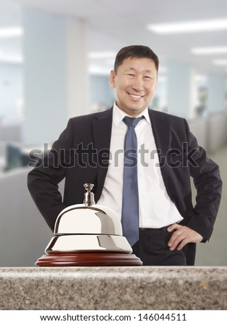 Asian hotel concierge.  Service bell at the hotel - stock photo