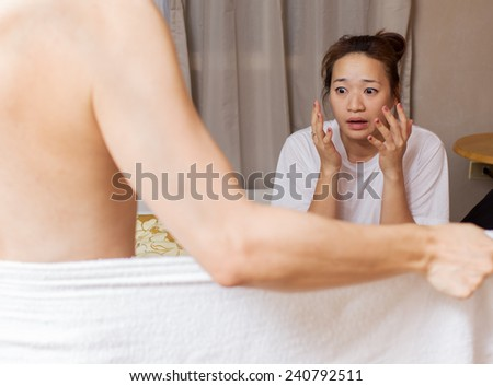 asian husband and his beautiful wife during intimacy / sex on bed - stock photo