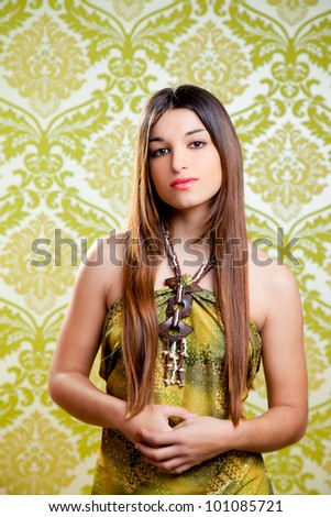 Asian Indian brunette beautiful girl with long hair on retro wallpaper - stock photo
