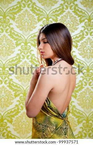 Asian Indian brunette beautiful girl with sexy open back dress - stock photo