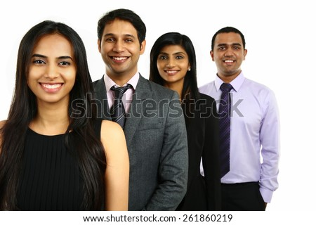 Asian Indian businessmen and businesswoman in group standing in a row isolated on white. Teamwork concept. - stock photo