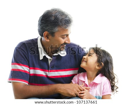 Asian Indian father having conversation with her daughter over white background - stock photo
