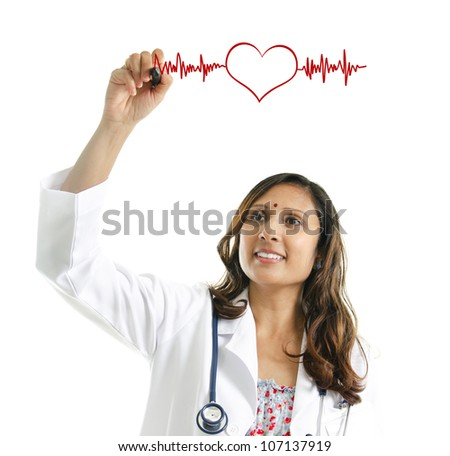 Asian Indian female doctor drawing a heartbeat over white background. Medical concept