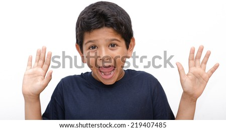 asian indian kid with different expressions in the face - stock photo