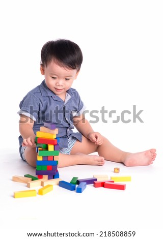 asian kid boy playing with block toys