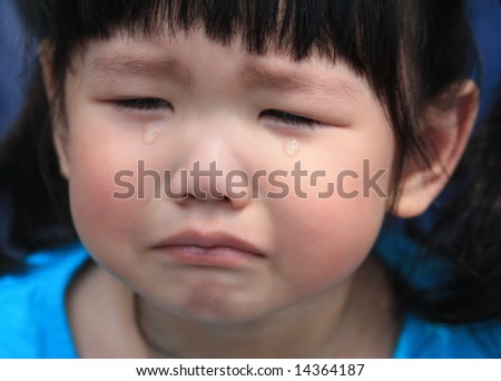 Asian kid crying in tears - stock photo
