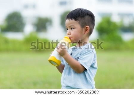 Asian kid drink with the water bottle - stock photo