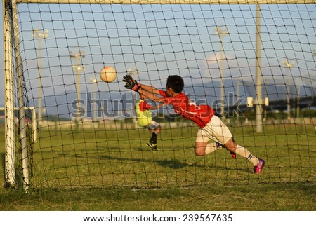 Asian Kid playing soccer