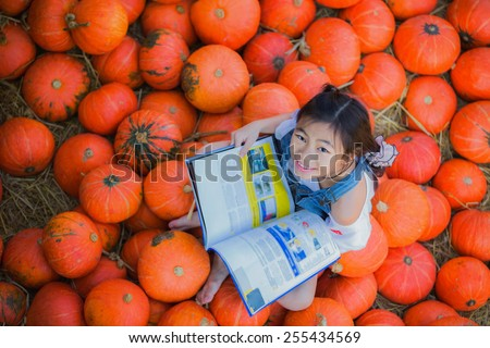 Asian kid reading a book in farm with top view photo - stock photo