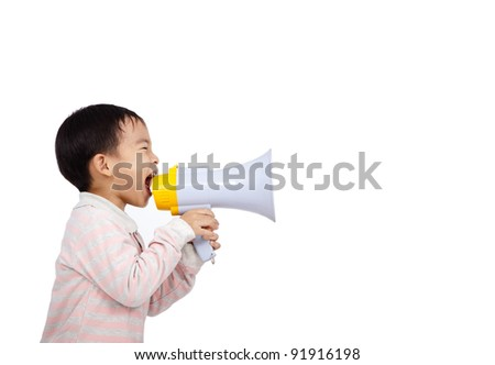 asian kid shouts something into the megaphone - stock photo