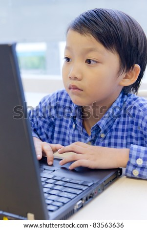 asian kid with laptop notebook