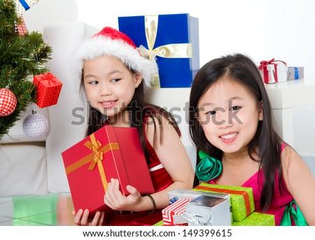 Asian kids holding christmas gift boxes - stock photo
