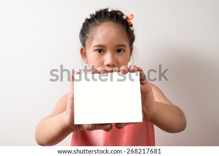asian kids holding white paper - stock photo