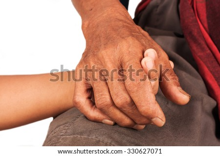 asian kids little boy hand touches and holds an old man wrinkled hands - stock photo