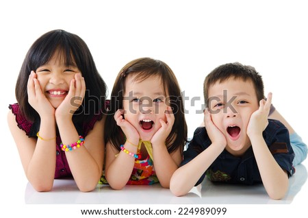 Asian kids lying on the floor - stock photo