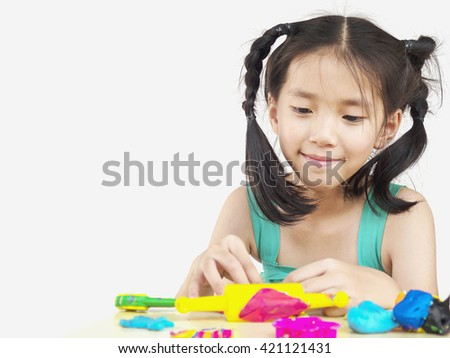 Asian kids playing colorful clay toy.Photo is focus at the face.