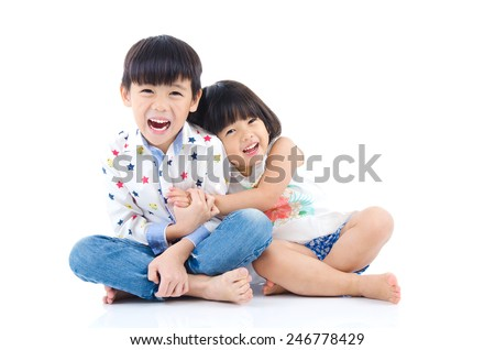 Asian kids sitting on the floor - stock photo