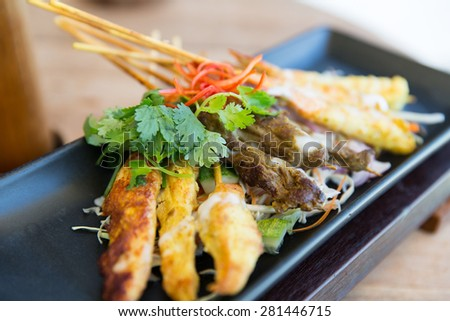 asian kitchen, food, culinary and cooking concept - close up of deep-fried snacks on plate at restaurant - stock photo