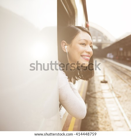 Asian Lady Traveling Commute Train Concept - stock photo