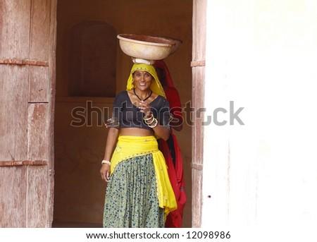 Asian lady wearing gray and yellow sari - stock photo