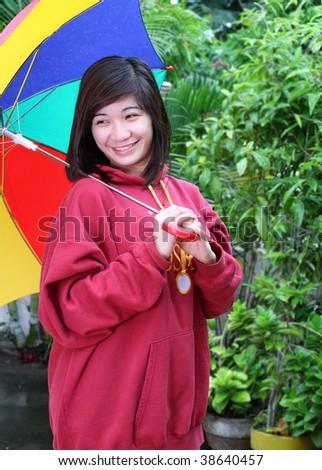 asian lady with umbrella - stock photo